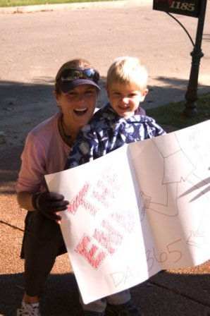 mother-and-son-happy-holding-poster