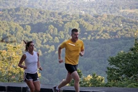 runners-over-mountain-setting