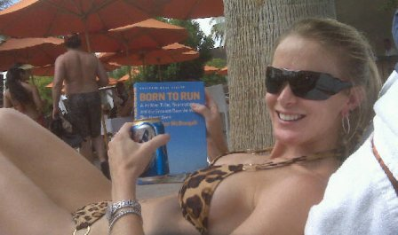 born-to-run-girl-in-swimsuit-reading-by-pool