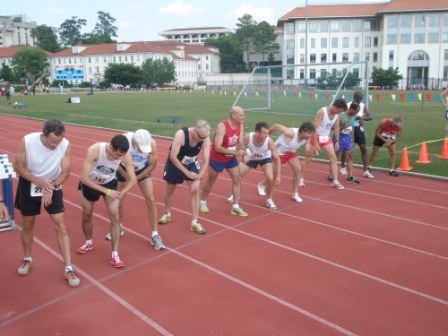 runners-at-start-line-on-track-race